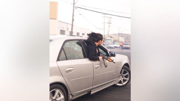 Passenger leaning out of car wields AK-47 at illegal San Francisco event