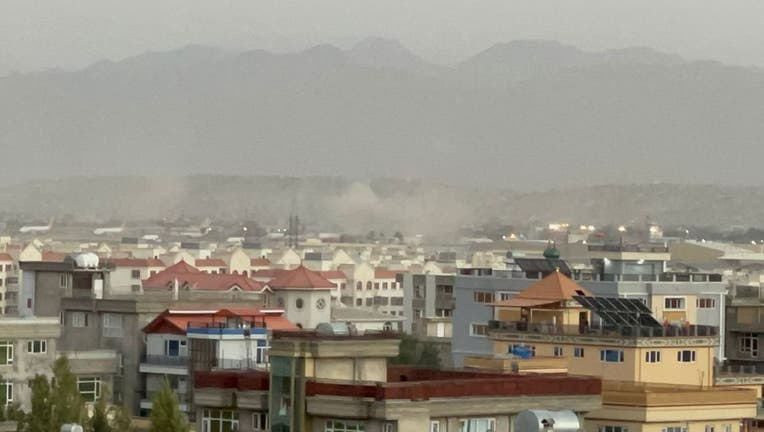 Smoke rises after two explosions reported outside Hamid Karzai International Airport, the center of evacuation efforts from Afghanistan since the Taliban took over in Kabul, Afghanistan on Aug. 26, 2021. (Photo by Haroon Sabawoon/Anadolu Agency via Getty Images)