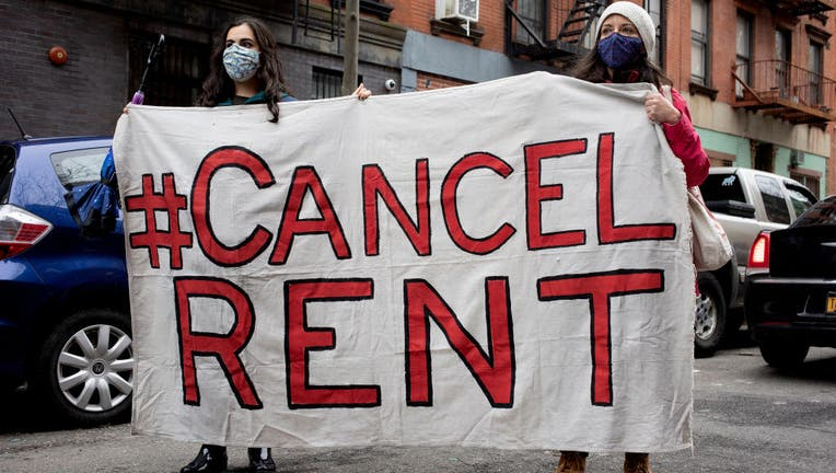 Tenant rights activists hold a demonstration outside the home of New York State Senator Brian Kavanagh to protest what they claim to be inadequate legislative relief for renters during the COVID-19 pandemic and to call for the cancellation of rent, February 28, 2021 in the East Village neighborhood of New York City. (Photo by Andrew Lichtenstein/Corbis via Getty Images)