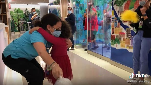 Tearful celebration: 5-year-old cancer patient can't let go of hospital worker as she hugs her in gratitude