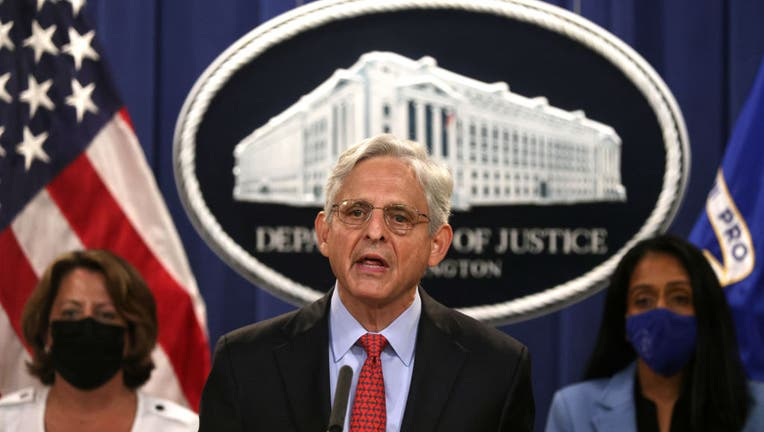 FILE - U.S. Attorney General Merrick Garland (C) speaks as Deputy Attorney General Lisa Monaco (L) and Associate Attorney General Vanita Gupta (R) listen during a news conference to announce a civil enforcement action at the Department of Justice on Sept. 9, 2021, in Washington, D.C. (Photo by Alex Wong/Getty Images)