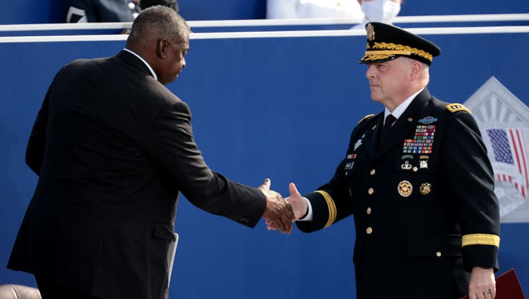 FILE - Secretary of Defense Lloyd Austin (L) shakes hands with Chairman of the Joint Chiefs of Staff Gen. Mark A. Milley during the Pentagon 9/11 observance ceremony at the National 9/11 Pentagon Memorial on Sept. 11, 2021, in Arlington, Virginia. (Photo by Win McNamee/Getty Images)