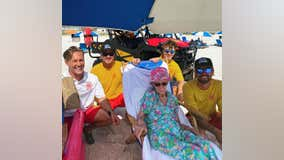 Alabama lifeguards help 95-year-old down to beach every day during her stay