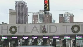 Christmas decorations moved on Holland Tunnel sign