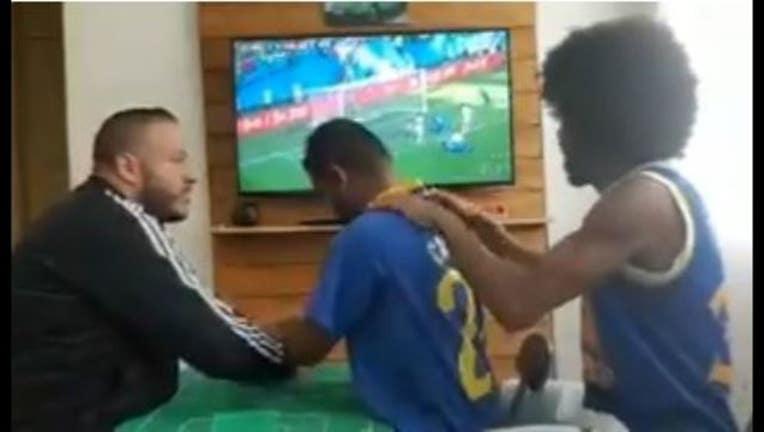 0f69faa8-Watch how these friends help deaf-blind Brazil fan experience World Cup goal-65880