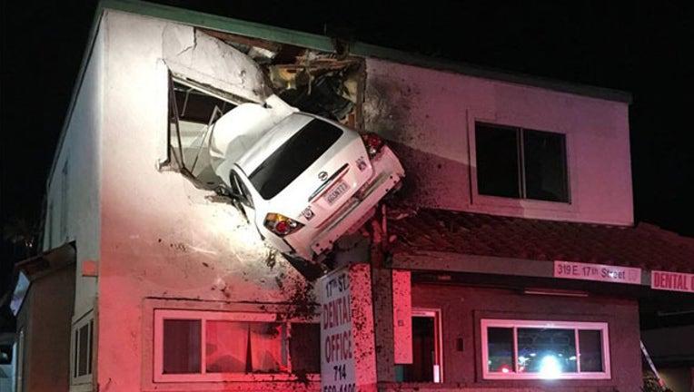3fb1fc20-Car into second floor building_1515953457798.jpg-407693.jpg