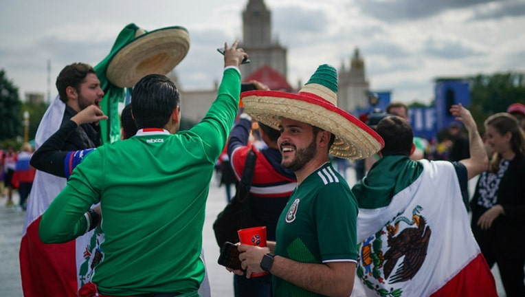 8edd5d38-GETTY Fans of Mexico in Moscow for the World Cup soccer games-404023