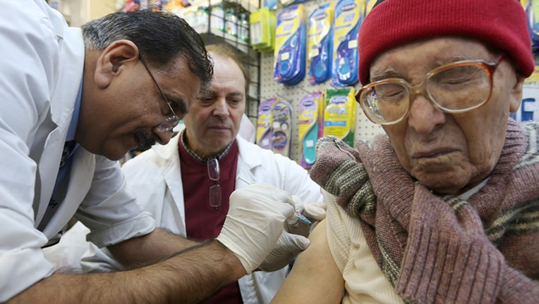 fec97bfa-Man injected with flu vaccine (GETTY)-408200
