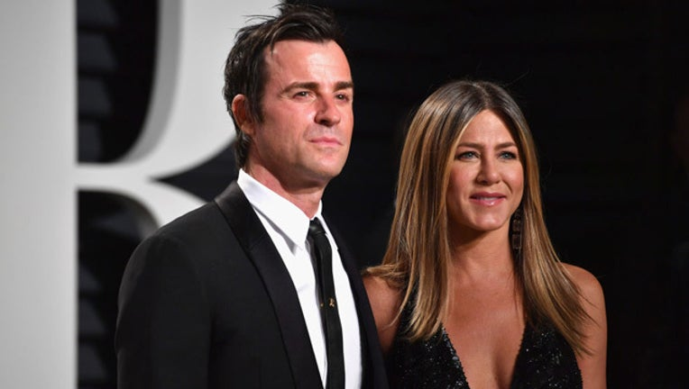 d7075122-aniston_theroux_695550813AP00090_2017_Vanit_1518738362509_getty_images-408795