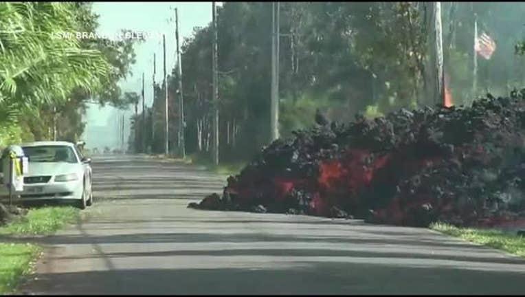 264424a1-Hawaii_volcano_destroys_homes__forces_ev_0_20180507202417-401385-401385