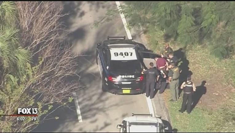 fe36eb48-Suspect_arrested_after_Broward_school_sh_0_20180214231319-401385-401385