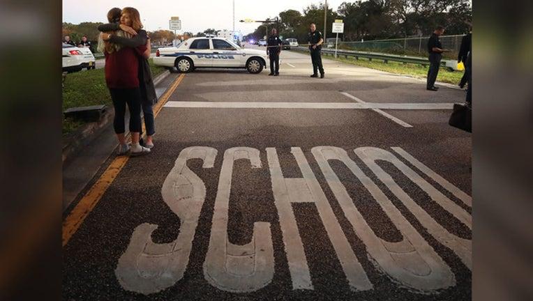 ef9e09fa-fla school shooting getty image_1518712960980.jpg-65880.jpg