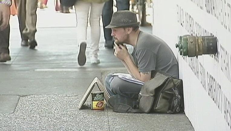 bfa282f5-man-sitting-on-sidewalk_1526583003608-402970.jpg