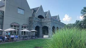 NJ country club drops waiter from ruined handbag lawsuit