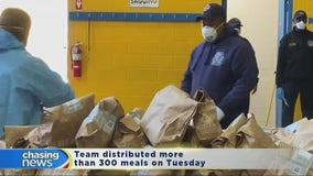 Newark firefighters pack and distribute food to the needy