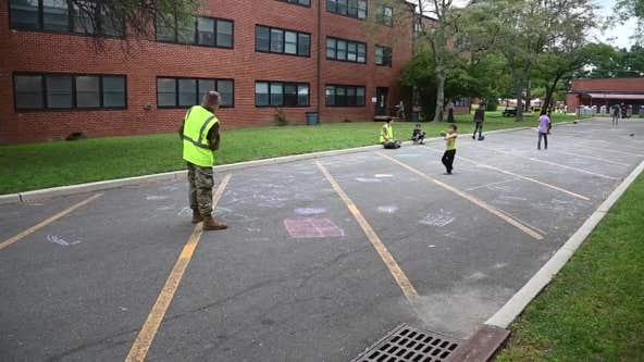Afghan children evacuees create chalk art at NJ military base