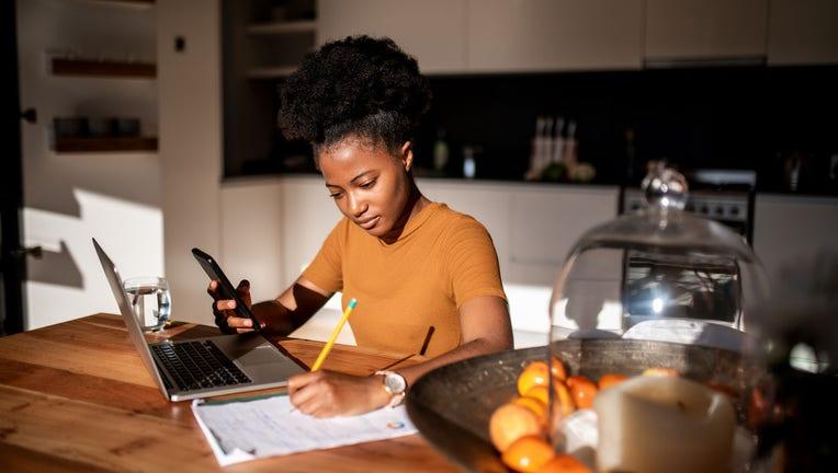 Credible-Millennials-refinance-student-loans-survey-iStock-1250917638.jpg