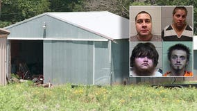Four arrested after 15-year-old found living with barn animals, eating twigs and grass