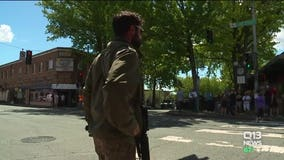 People grab rifles and board up to protect Kirkland businesses from looters