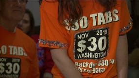 $30 car tab measure passes in Washington, billions to be cut