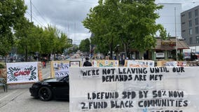 CHOP protesters staying put at Seattle police precinct