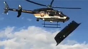 Watch police helicopter send tailgate tents flying in attempt to break up rowdy party at Penn State