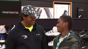 Russell Wilson surprises at-risk kids with shopping spree