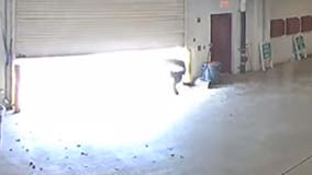 Video shows inmate escape jail by diving under closing garage door