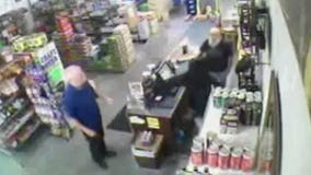 Video shows beer store owner foiling robbery attempt, taking down armed suspect