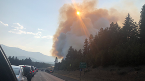 Car fire on I-90 sparks brush fire near Cle Elum; WB lanes affected