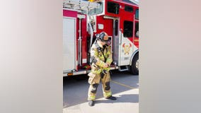 Firefighter stands for 1 minute for every firefighter who died on 9/11