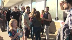 Canadian girl sells out of cookies in minutes to crowd outside marijuana store