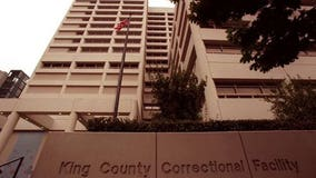 Woman found dead in apartment after man turns himself in at King County Jail