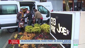 Kenmore man donates more than 7,900 pairs of socks to Q13 Season of Giving Sock Drive