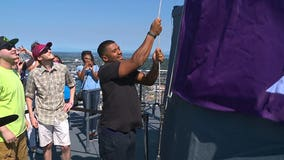 Russell Wilson raises flag at Space Needle for Childhood Cancer Awareness Month