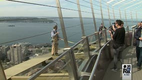 Reward for quickly racing up the Space Needle's 832 steps? Walking on the outside of the halo...