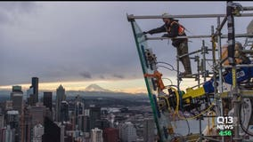 Glass panels weighing over a ton each being installed on Space Needle