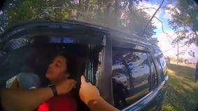 Video shows police officer, good Samaritan bend door of burning car to free women