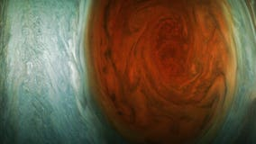 Spacecraft reveals beauty of solar system's biggest storm