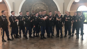 Newborn daughter of fallen soldier has photo shoot with father's Army unit