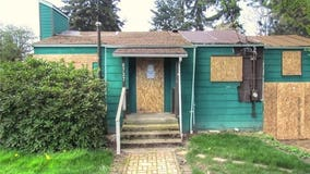 Half a million dollars could buy you this boarded up Seattle home