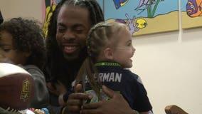 Richard Sherman surprises Mary Bridge Children's patient who lost her favorite doll