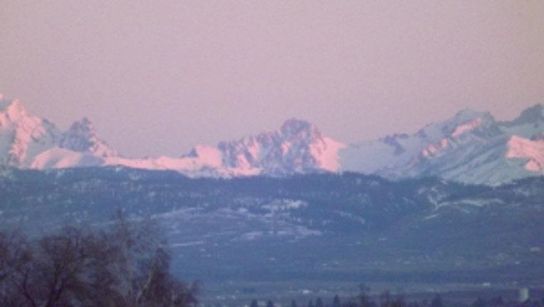Sunrise over the Stuarts. From Karen in Ellensburg.