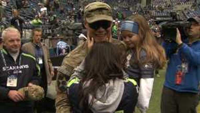 Dad returns from tour Seahawks game