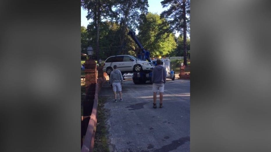 The minivan was pulled from the creek bed Friday morning.