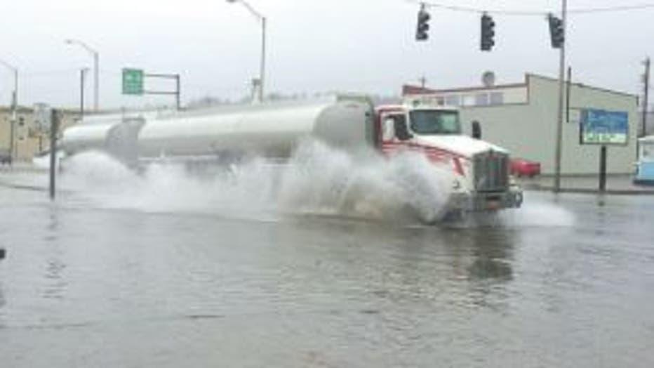 semi driving flooded street