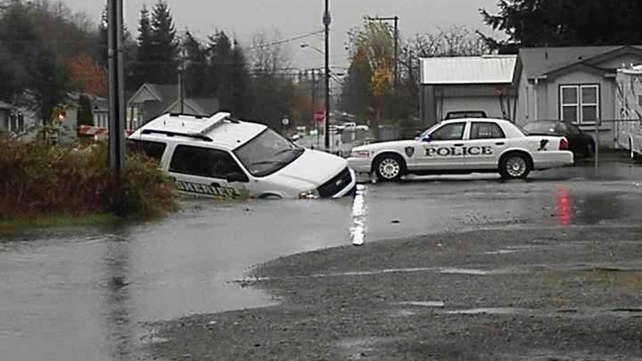 sheriff's car in storm