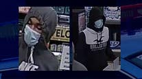 Help ID masked armed robbers who took their time before striking, holding gun to store clerk's head for cash