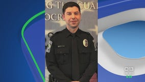 Court documents say partner fired shot that killed Bothell officer