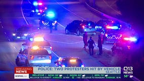 Police: 2 people hit by car on Seattle highway amid protests